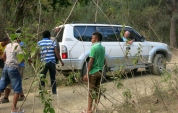 You have to be an all-rounder in Timor. Here Pat uses his rented 4-wheel drive to help pull a truck out of a ditch.