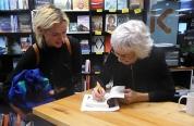 Pip signs a book for Matilda Newland, a fellow singer in the Wellington Community Choir.