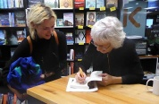 Pip signs a book for Matilda Newland, a fellow singer in the Wellington Community Choir.